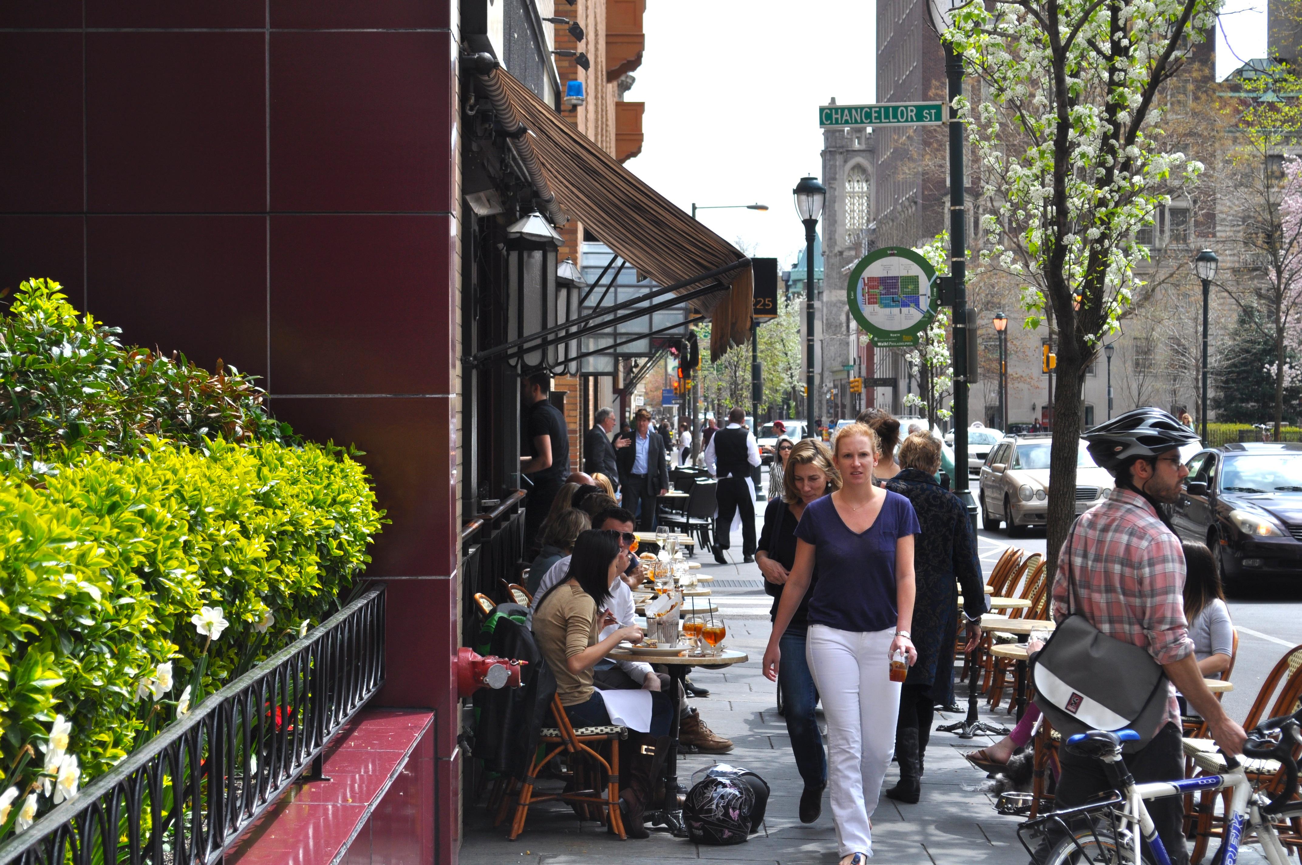 Photo of people walking through downtown Philadelphia