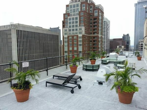 Rooftop sundeck with lounge seating and views of downtown Philadelphia