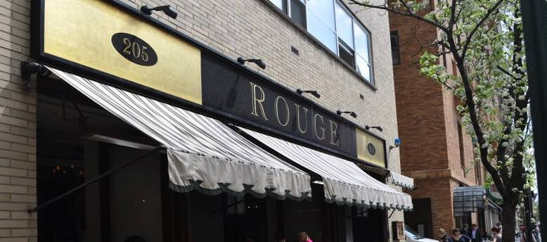 Rouge restaurant awning with sign